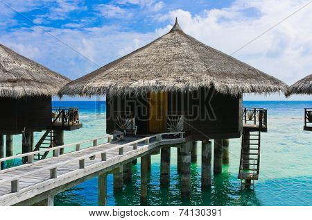 Water bungalows at a tropical island - travel background