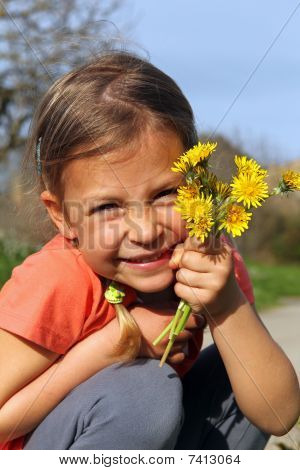 Girl holding daisies