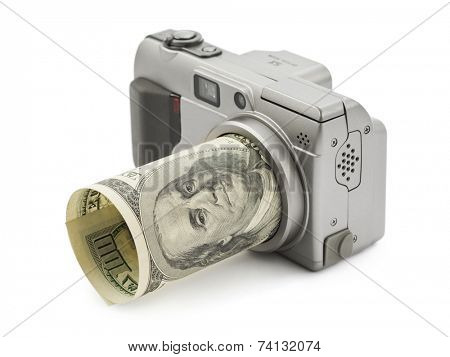 Photo camera and money isolated on white background