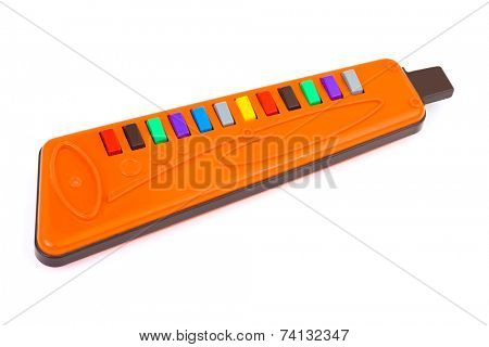 Toy music pipe isolated on white background