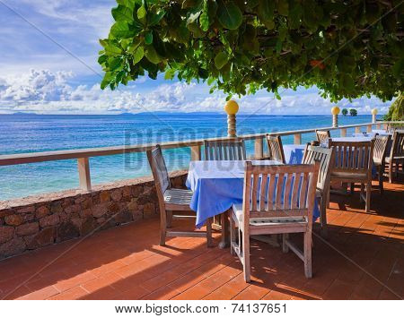 Cafe on tropical beach - travel background