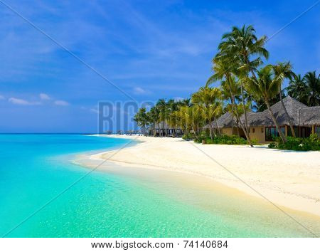 Beach bungalows on a tropical island, travel background