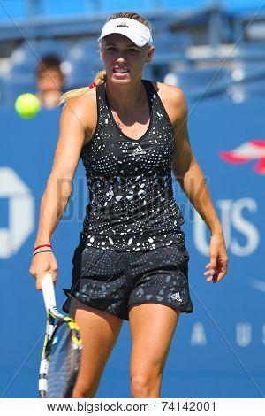 Professional tennis player Caroline Wozniacki practices for US Open 2014
