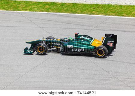 SEPANG, MALAYSIA - APRIL 8: Heikki Kovalainen (team Lotus) at first practice on Formula 1 GP, April 8, 2011 in Sepang, Malaysia.