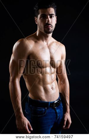 Beautiful And Muscular Man In Dark Background.
