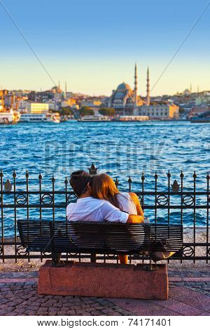 Man and woman on bench at Istanbul Turkey - love background
