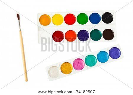 Paintbrush and paints isolated on white background