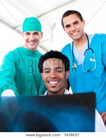 Hopeful Male Doctors Looking At X-ray