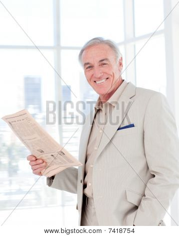 Portrait Of A Smiling Manager Reading Newspaper