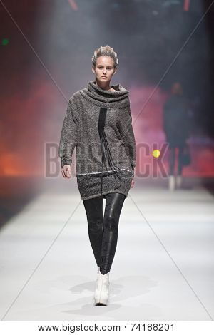 ZAGREB, CROATIA - OCTOBER 18, 2014: Fashion model wearing clothes designed by Marina Design on the 'Fashion.hr' fashion show
