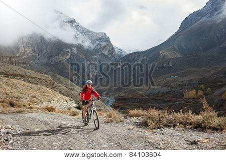 happy Biker-girl in Himalaya mountains Anapurna region poster