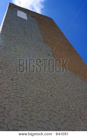 Detail Perspective Of Textured Wall Against Blue Sky