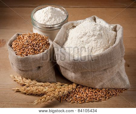 Wheat And Flour In The Bag, Jar On The Boards. Spikelets