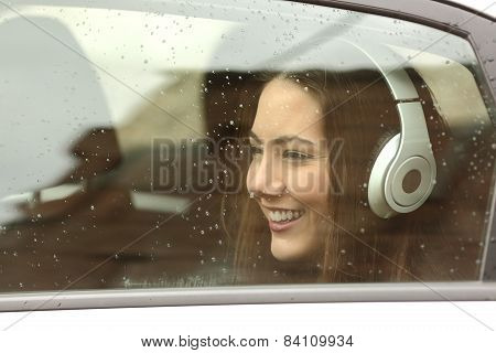 Teenager With Headphones Listening To The Music In A Car