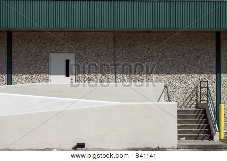 Warehouse door with staircase entry