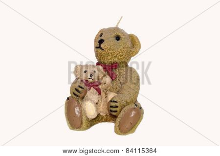 Large wax teddy bear candle. the larger bear has a small bear sitting on its leg poster