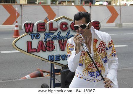 Street Artist Imitates Elvis Presley