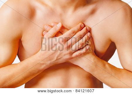 Man is clutching his chest acute pain possible heart attack. On a white background poster
