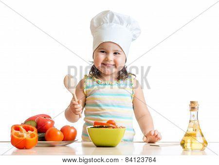 kid girl preparing healthy food at kitchen poster