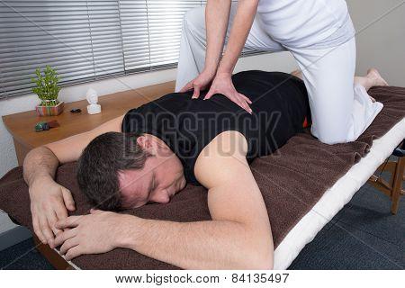 Man receiving a shiatsu massage