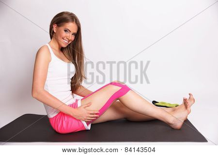 Woman After Leg Injury With Kinesio Tape