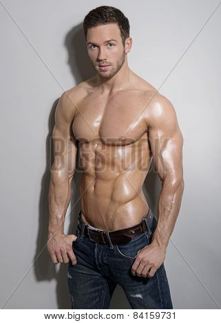 handsome young muscular man posing shirtless
