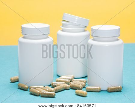 Scattered capsules with white plastic jars. Blue and yellow background poster