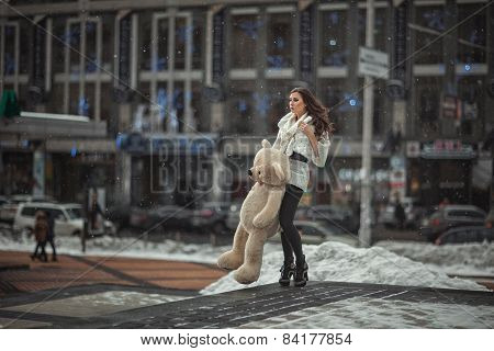 The Girl With A Toy Bear In The City.