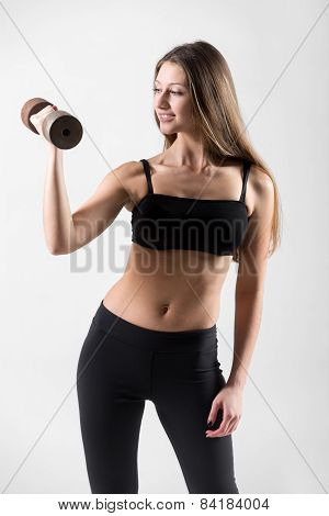 Smiling Young Girl Doing Weightlifting