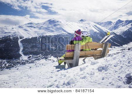 Young couple hugging ski resort winter mountains