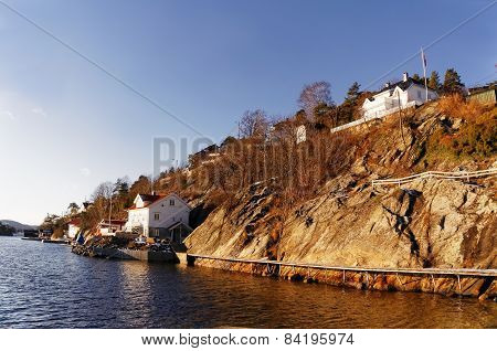 Wooden Path On Steep Bank Of Fjord