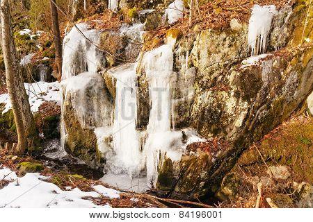 Ice Overhangs On Rocks
