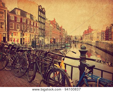 Amsterdam. The Singel is one of the numerous canals in Amsterdam, Netherlands Photo in retro style. Added paper texture. Toned image