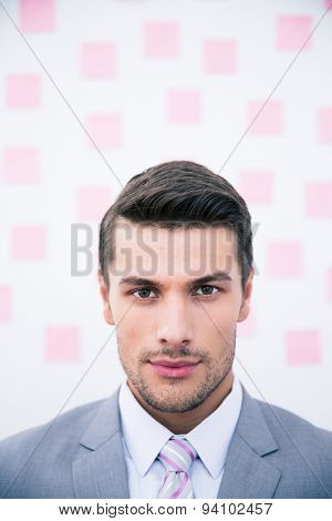 Portrait of a young handsome businessman looking at camera