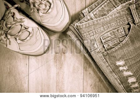 Gray Mens Boots With Jeans On Wooden Background