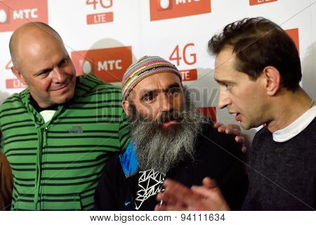 ST. PETERSBURG, RUSSIA - JUNE 19, 2015: Actor Konstantin Khabensky (right), choreographer Nikolay Reutov (center), and singer Alexey Kortnev talk with press after the musical Mowgli Generation