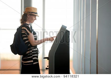 Woman Doing Self-check-in In Airport