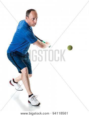 Tennis action shot. Backhand. Studio shot over white.
