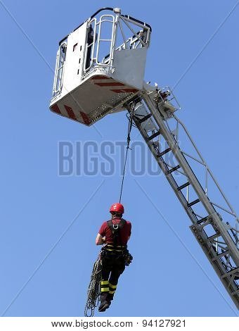 Firefighter Hung The Rope Climbing During The Practical Exercise In Firehouse