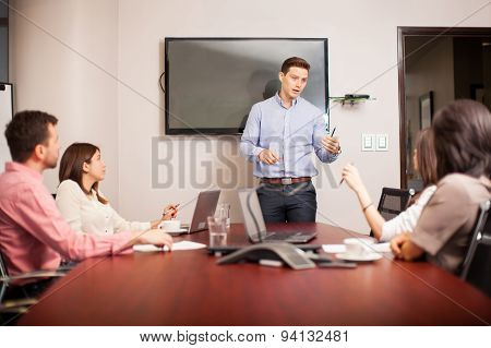 Young Boss Leading A Meeting