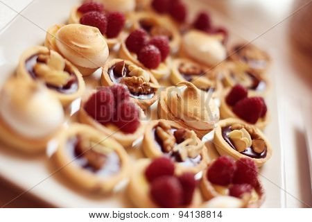 Delicious Mini Tarts With Berries And Almonds
