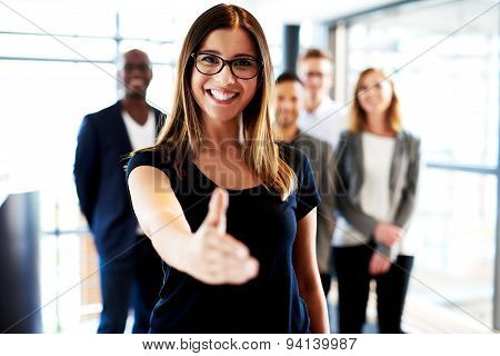 Young Female Executive Standing With Hand Out