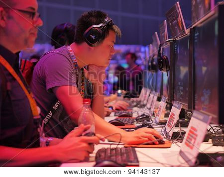 LOS ANGELES - June 17: Gamers playing demo video games at E3 2015 expo. Electronic Entertainment Expo, commonly known as E3, is an annual trade fair for the video game industry