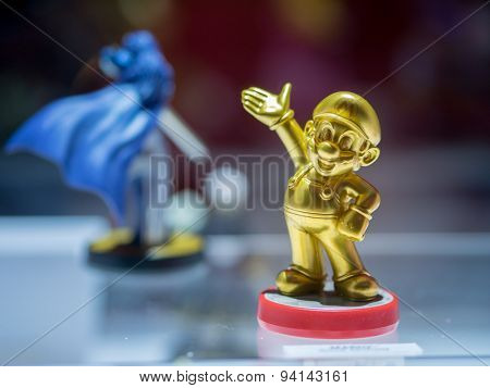 LOS ANGELES - June 16, 2015: Golden Mario Amiibo figure on display at E3 2015 expo. Electronic Entertainment Expo, commonly known as E3, is an annual trade fair for the video game industry.