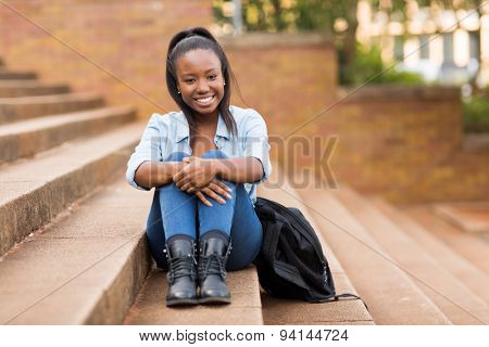 carefree pretty african college girl outdoors on campus
