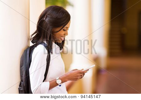 pretty female afro american university student using cell phone