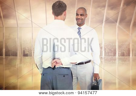 Businessman holding knife behind his back against room with large window looking on city
