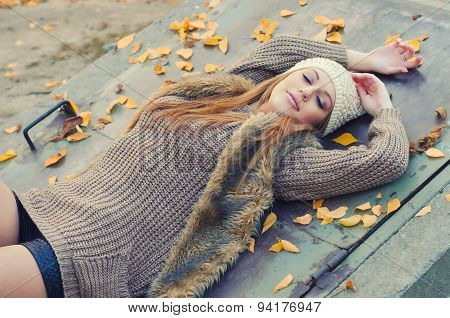 Beautiful Girl Relaxing In The Nature On Colorful Autumn Day