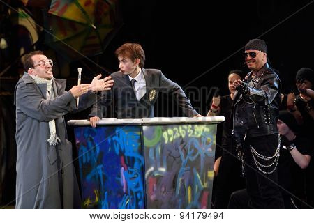 ST. PETERSBURG, RUSSIA - JUNE 19, 2015: Actor Konstantin Khabensky (left) and singer Alexey Kortnev (right) perform in a scene from a children's charity project titled Mowgli Generation