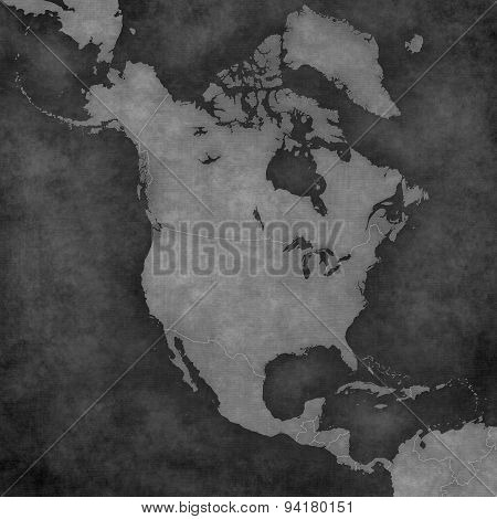 Blank map of North America with country borders. The map is in vintage black and white style. The map has soft grunge and retro old paper atmosphere.